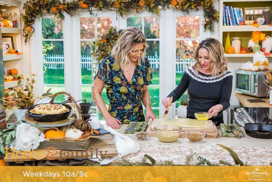 "Debbie Matenopoulos and Cameron Mathison welcome ""High Alpine Cuisine"" author, Marla Meridith whips up cast-iron skillet cinnamon rolls with maple pumpkin cream cheese frosting. Credit: © 2018 Crown Media United States, LLC 